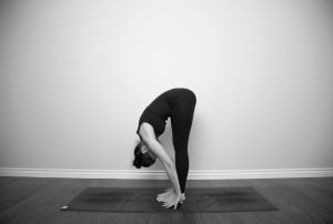 stock-photo-uttanasana-hands-on-floor